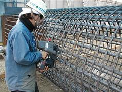 Construction site where reinforced steel is fixed with an automatic rebar tier